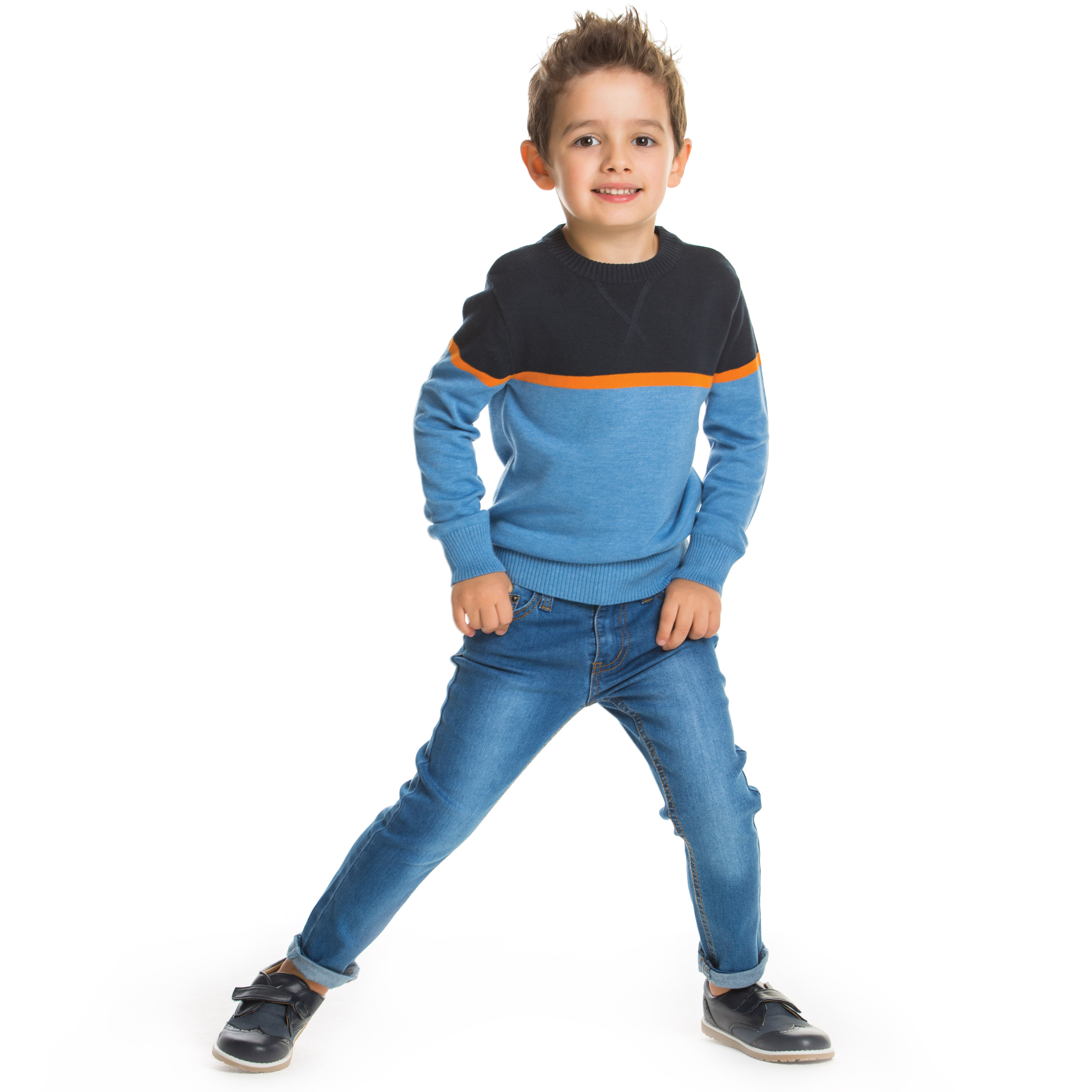 Junior boy wearing a sweater and jeans