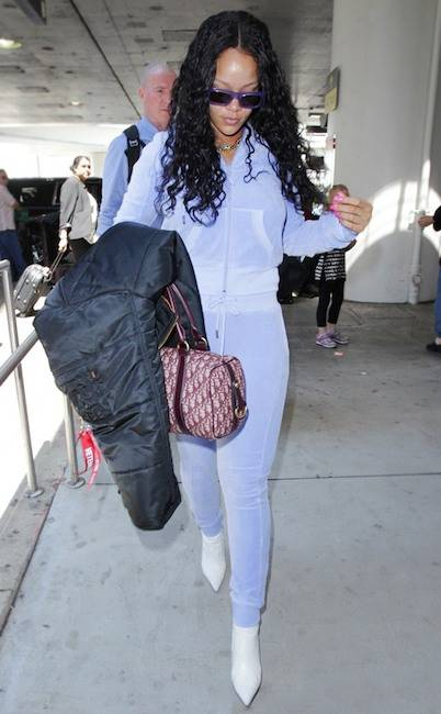 Rihanna in a blue velour tracksuit