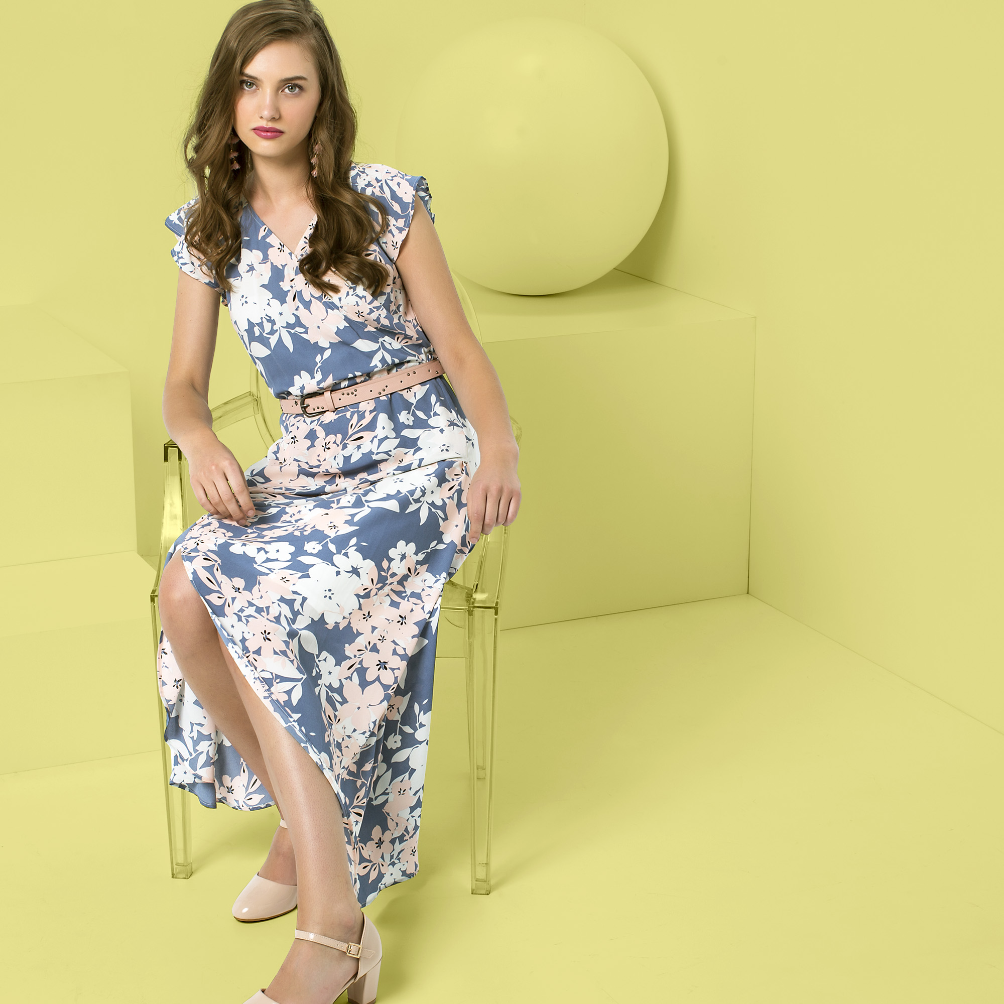 a woman wearing pastel dress